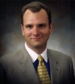 Managing Director, Arik R. Johnson
